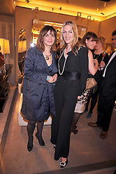 Left to right, SUNETRA ATKINSON and PRICILLA WATERS at a reception in aid of Children in Crisis held at the Roger Vivier store, 188 Sloane Street, London on 19th March 2009.