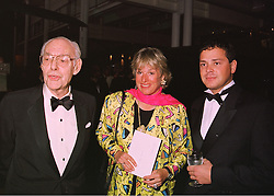 Left to right, SIR DENIS THATCHER, his daughter MISS CAROL THATCHER and MR MARCO GRASS, at a fashion show in London on 12th May 1998.MHL 39