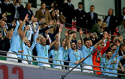 Manchester City players celebrate from the stands after winning the Carabao Cup Final at Wembley Stadium, London.