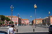 Fontaine du soleil fountain and statue of Apollo in Place Massena square, Nice, France