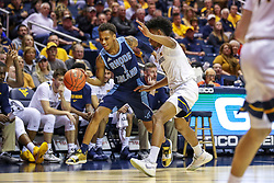 Dec 1, 2019; Morgantown, WV, USA; Rhode Island Rams guard Fatts Russell (1) dribbles alone the sideline while defended by West Virginia Mountaineers guard Miles McBride (4) during the first half at WVU Coliseum. Mandatory Credit: Ben Queen-USA TODAY Sports