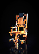 Electric chair in dark room.