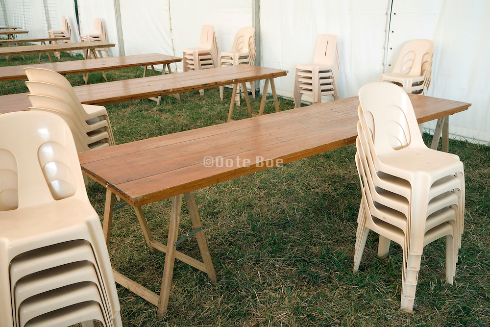 stacked chairs and tables for a big outdoor party