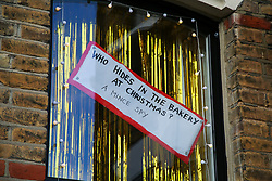 © Licensed to London News Pictures. 16/12/2020. London, UK. A Christmas joke form a decoration in windows of a house in north London. Photo credit: Dinendra Haria/LNP