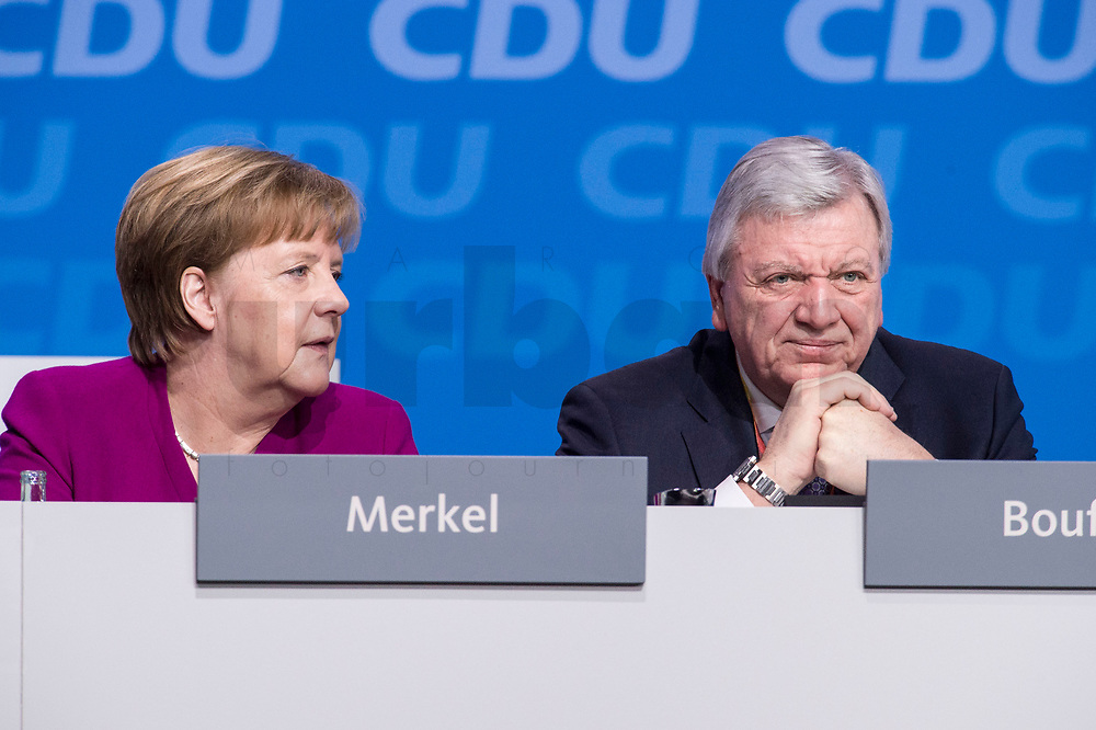 26 FEB 2018, BERLIN/GERMANY:<br /> Angela Merkel (L), CDU, Bundeskanzlerin, und Volker Bouvier (R), CDU, Ministerpraesident Hesen, CDU Bundesparteitag, Station Berlin<br /> IMAGE: 20180226-01-023<br /> KEYWORDS: Party Congress, Parteitag