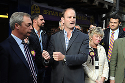 © Licensed to London News Pictures. 11/10/2014<br />   UKIP MP Douglas Carswell talking in Rochester,Kent outside UKIP shop 30 Rochester High Street with Nigel Farage  and Mark Reckless.<br /> UKIP Leader Nigel Farage  in Rochester today (11.10.2014)with Mark Reckless and new UKIP MP for Clacton Carswell.<br /> (Byline:Grant Falvey/LNP)