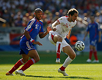 Photo: Glyn Thomas.<br />France v Switzerland. Group G, FIFA World Cup 2006. 13/06/2006.<br /> France's Thierry Henry (L) and Switzerland's Patrick Mueller.
