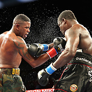"""Yuniel Dorticos (left) beats Edison Miranda during the """"Judgement Day"""" boxing event at American Airlines Arena on Thursday, July 10, 2014 in Miami, Florida.  (AP Photo/Alex Menendez)"""