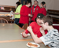 "Michael Cavette and Caelan Norwood try to determine the ""Best Pizza in Town"" during NH JAG's 4th annual event held Thursday evening at Laconia High School.  (Karen Bobotas/for the Laconia Daily Sun)"