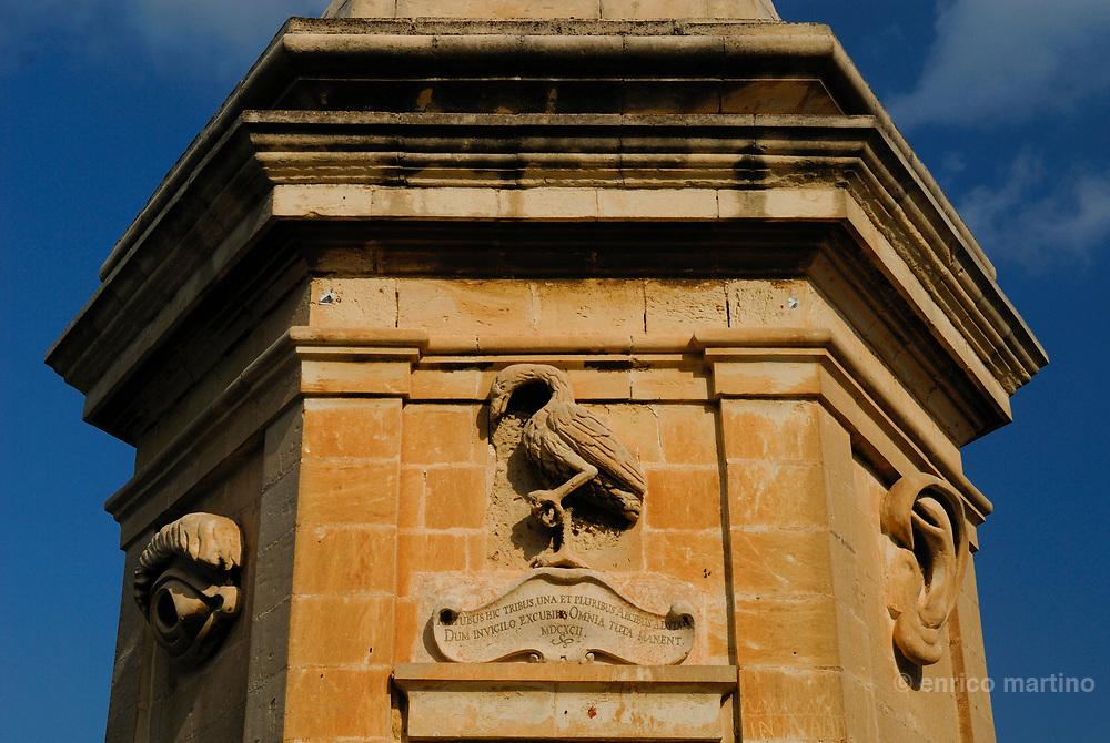 Senglea, Safe Haven Garden. The famous stone Vedette, known as il-Gardjola, served as a look-out post. The sculptured eye and ear above its windows are symbols of vigilance.