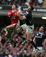 James Hook of Wales jumps to catch the ball with Scotland's Graeme Morrison. RBS Six nations, Wales v Scotland at the Millennium stadium, Cardiff on Sat 13th Feb 2010. pic by  Andrew Orchard sports photography,