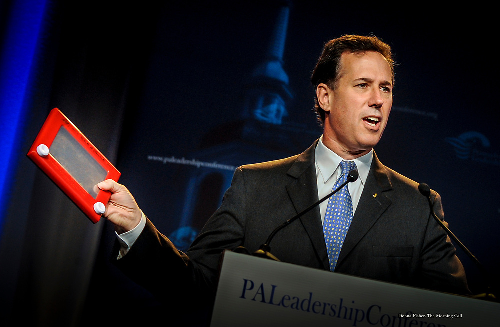Republican presidential contender Rick Santorum clutches his Etch A Sketch while speaking at the Pennsylvania Leadership Conference in Camp Hill Saturday, March 24, 2012.