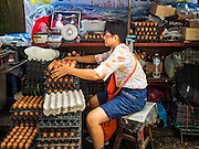 21 SEPTEMBER 2016 - BANGKOK, THAILAND: An egg vendor in her street stall next to what used to be the Bang Chak Market. She used to have a shop in the market. She moved out to the street when the market was closed. The market closed permanently on January 4, 2016. The Bang Chak Market served the community around Sois 91-97 on Sukhumvit Road in the Bangkok suburbs. Bangkok city authorities put up notices in late November 2015 that the market would be closed by January 1, 2016 and redevelopment would start shortly after that. Market vendors said condominiums are being built on the land.      PHOTO BY JACK KURTZ