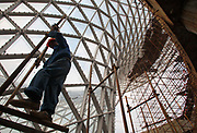 Workers operate at one of the construction site for the 2010 Shanghai World Expo in Shanghai, China on 26 August 2009. The Shanghai World Expo will eventually see a record breaking 70 million visitors during its six months duration.