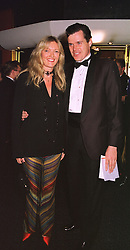 MISS ANNABEL HESELTINE daughter of former Conservative deputy Prime Minister Michael Heseltine and her fiance MR PETER BUTLER, at a film premier on 26th August 1998.MJL 61