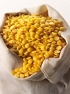 un-cooked organic yellow lentils - stock photos