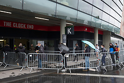 © Licensed to London News Pictures. 07/08/2021. London, UK. People brave the heavy rain weather queuing outside the ARSENAL EMIRATES STADIUM to attend the second mass Covid 19 vaccination event. Photo credit: Ray Tang/LNP