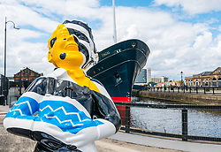 Pictured: Oor Wullie Bucket Art Trail. Leith, Edinburgh, Scotland, United Kingdom, 17 June 2019. An art trail of 200 Oor Wullie sculptures have appeared in Scottish cities overnight in a mass arts event that lasts until August 30th. The sculptures will be auctioned to raise money for Scotland's children's hospital charities. There are 5 in the Leith area, and 60 in Edinburgh altogether. Bobby Dazzler by Scott Dawson and Rachel Miller next to Fingal Edinburgh in Leith Docks.<br /> <br /> <br /> Sally Anderson   EdinburghElitemedia.co.uk