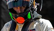Image of Gunnar Jeannette getting ready to race his Gunnar Racing Porsche at Rennsport Reunion VI at Weathertech Raceway Laguna Seca, Monterey, California, America west coast by Randy Wells