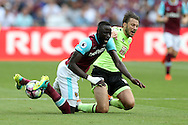 Cheikhou Kouyate of West Ham United is pulled back by Harry Arter of AFC Bournemouth for which Referee Craig Pawson gives Harry Arter of AFC Bournemouth a second yellow and red card and is sent off. .Premier league match, West Ham Utd v AFC Bournemouth at the London Stadium, Queen Elizabeth Olympic Park in London on Sunday 21st August 2016.<br /> pic by John Patrick Fletcher, Andrew Orchard sports photography.