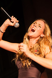 Covent Garden, London, October 30th 2014. Multi-platinum selling artist Joss Stone performs two numbers with legendary guitarist Jeff Beck as part of the events in Covent Garden where London Poppy Day events were held as the Royal British Legion raises funds, with over £1 million expected to be raised. PICTURED: Joss Stone.