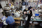 "Students in the laboratory of Professor Fumio Hara and Hiroshi Kobayashi at Science University of Tokyo work on their various robot projects, including the labs' first generation face robot. This three-dimensional human-like animated pneumatic face robot can recognize human facial expressions as well as produce realistic facial expressions in real time. The animated face robot, covered in latex ""skin"" is equipped with a CCD camera in the left eye and is able to collect facial image data that is used for on-line recognition of human facial expressions."