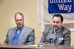 Jack Terrell and Patrick Tufts discuss the ramifications of the the merger of Lakes Region United Way and Granite United Way during a press conference on Tuesday, January 22, 2013.  (Alan MacRae/for the Laconia Daily Sun)