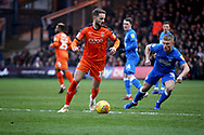 Luton Town midfielder AndrewShinnie (11) watch by Peterborough Utd's Kyle Dempsey (30) during the EFL Sky Bet League 1 match between Luton Town and Peterborough United at Kenilworth Road, Luton, England on 19 January 2019.