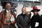 April 8, 2018-New York, New York-United States: (L-R) Documentary Photographer Jamel Shabazz, Photographic Artists Shawn Theodore and Baron Claiborne attend the Photography Show presented by AIPAD held at Pier 94 on April 8, 2018 in New York City. The Photography Show, held at Pier 94, is the longest-running and foremost exhibition dedicated to the photographic medium, offering contemporary, modern, and 19th century photographs as wells photo-based art, video and new media.(Photo by Terrence Jennings/terrencejennings.com)