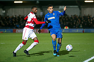 AFC Wimbledon defender Rod McDonald (4) battles for possession during the EFL Sky Bet League 1 match between AFC Wimbledon and Doncaster Rovers at the Cherry Red Records Stadium, Kingston, England on 14 December 2019.