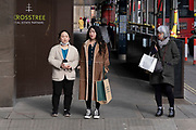 Waiting to cross the road, some wear a face mask while others do not on Piccadilly as the national coronavirus lockdown three continues on 5th March 2021 in London, United Kingdom. With the roadmap for coming out of the lockdown has been laid out, this nationwide lockdown continues to advise all citizens to follow the message to stay at home, protect the NHS and save lives, and the streets of the capital are quiet and empty of normal numbers of people.