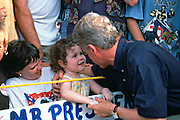 DYERSBURG, TN - August 31: US President Bill Clinton speaks to a small girl during a campaign stop on their bus tour August 31, 1996 in Dyersburg, TN.     (Photo Richard Ellis)