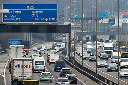 ©  London News Pictures. 28/03/2013. London, UK. Heavy traffic moving slowly on the M25 at junction 16, the day before the easter bank holiday begins. Photo credit : Ben Cawthra/LNP