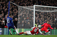 Eden Hazard of Chelsea (L) takes a shot at goal which is saved by David Ospina of Arsenal (R). Carabao Cup , semi final 1st leg match, Chelsea v Arsenal at Stamford Bridge in London on Wednesday 10th January 2018.<br /> pic by Steffan Bowen, Andrew Orchard sports photography.