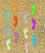 Digitally painted image of two colourful sets of footprints in sand . A concept for togetherness