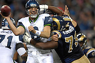 Seattle Seahawks quarterback Matt Hasselbeck (8) is pressured by St. Louis Rams nose tackle Jimmy Kennedy (73) in the first quarter at the Edward Jones Dome in St. Louis, Missouri, October 15, 2006.  The Seahawks beat the Rams 30-27.<br />