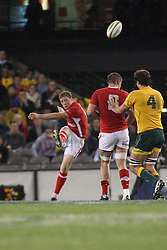 © Licensed to London News Pictures. 16/06/2012. Etihad Stadium, Melbourne Australia.Alex Cuthbert of Wales kicks the ball from the back row during the 2nd Rugby Test between Australia Wallabies Vs Wales . Photo credit : Asanka Brendon Ratnayake/LNP