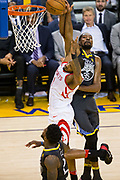 Golden State Warriors forward Kevin Durant (35) fouls Houston Rockets forward Trevor Ariza (1) during Game 4 of the Western Conference Finals at Oracle Arena in Oakland, Calif., on May 22, 2018. (Stan Olszewski/Special to S.F. Examiner)