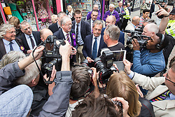 © Licensed to London News Pictures . 05/06/2014 . Newark , Nottinghamshire , UK . UKIP candidate Roger Helmer and leader Nigel Farage outside the UKIP shop surrounded by media in Newark today (Thursday 5th June 2014) as voting takes place in the Newark by-election , following the resignation of incumbent Patrick Mercer . Photo credit : Joel Goodman/LNP