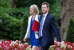 © Licensed to London News Pictures. 10/07/2018. London, UK. Secretary of State for Culture, Media and Sport Jeremy Wright QC (R) and Chief Secretary to the Treasury Elizabeth Truss (L) arrive on Downing Street for the Cabinet meeting. Photo credit: Rob Pinney/LNP