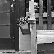 A wood bench in front of an old store front in Ashland, Oregon