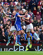 Nathan Baker ® and Alan Hutton (l) of Aston Villa battles with Lukas Jutkiewicz of Birmingham . EFL Skybet championship match, Aston Villa v Birmingham city at Villa Park in Birmingham, The Midlands on Sunday 23rd April 2017.<br /> pic by Bradley Collyer, Andrew Orchard sports photography.