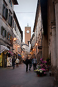 Street scene and view of Torre del Moro clock tower from Corso Cavour, Orvieto, Umbria, Italy.
