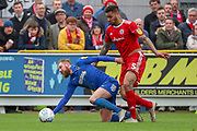 Accrington Stanley defender Ben Richards-Everton (5) fouling AFC Wimbledon midfielder Scott Wagstaff (7) during the EFL Sky Bet League 1 match between AFC Wimbledon and Accrington Stanley at the Cherry Red Records Stadium, Kingston, England on 6 April 2019.