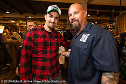 70's helmets Fabrizio Caoduro and custom builder Bryan Buttera at the Friday night Rokker Apparel party during the Swiss-Moto Customizing and Tuning Show. Zurich, Switzerland. Friday, February 22, 2019. Photography ©2019 Michael Lichter.