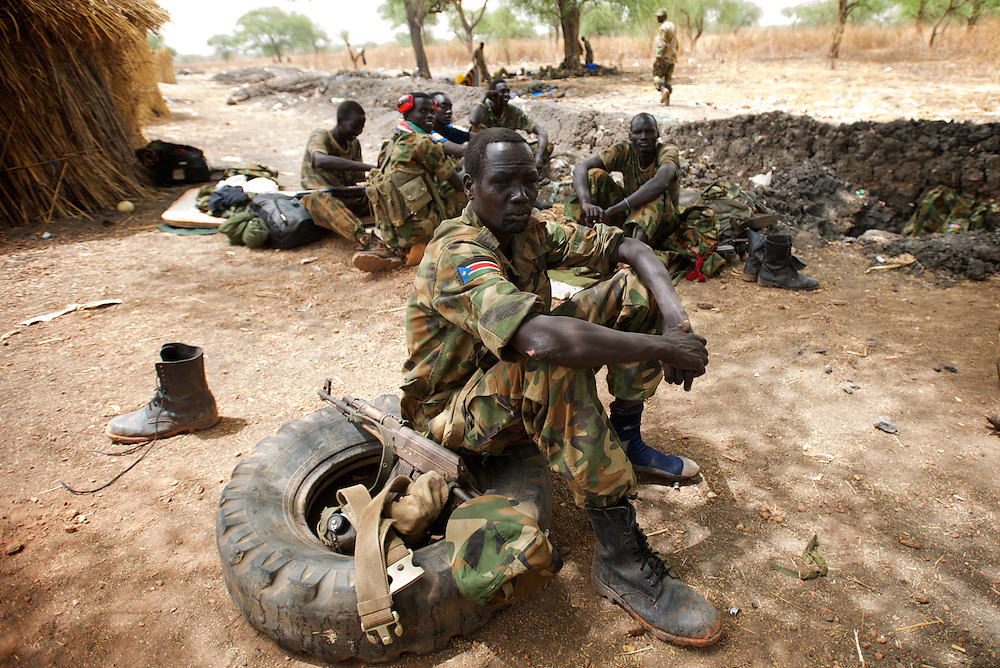 April 24, 2012 - Lalop, South Sudan: A group of SPLA soldiers rest at the newly established military base in the village o Lalop, 50 kilometers north of Bentiu...South Sudan and their northern neighbors, Sudan, have in the past two weeks been involved in heavily clashes over border disputes. Bentiu and neighboring villages have been under constant bombardment by the troops os Karthoum , who established their positions around 10 kilometers into South Sudan's territory. The international community is concerned about the possibility of a full on war between the two countries. (Paulo Nunes dos Santos/Polaris)
