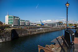 Cardiff, UK. 2nd May, 2017. Modern apartment blocks and the Techniquest science and discovery centre (r) are viewed across Mount Stuart graving docks close to Cardiff Bay.
