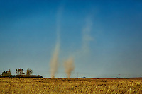 Twin dust devils spin up in central Washington on a hot summer day