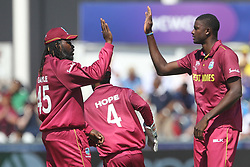 July 1, 2019 - Chester Le Street, County Durham, United Kingdom - West Indies' Chris Gayle high fives Jason Holder after Holder dismissed Sri Lanka's Dimuth Karunaratne during the ICC Cricket World Cup 2019 match between Sri Lanka and West Indies at Emirates Riverside, Chester le Street on Monday 1st July 2019. (Credit Image: © Mi News/NurPhoto via ZUMA Press)
