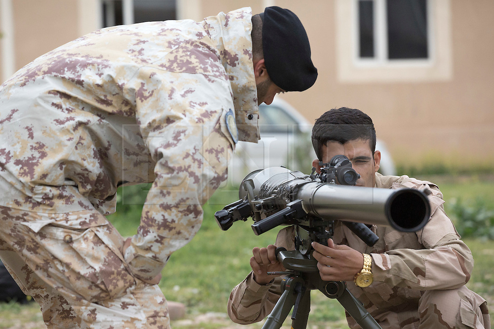 © Licensed to London News Pictures. 30/03/2015. Erbil, Iraq. A Kurdish peshmerga fighter learns how to use the sights on the Breda Folgore 80mm anti-tank recoilless rifle by Italian soldiers during a training package held at a military training area near Erbil, Iraq.<br /> <br /> Italy has donated 50 of the anti-tank weapons and 1000 rockets to the peshmerga.<br /> <br /> The training is part of a four week long package, the first to be held with a complete peshmerga battalion, run by coalition forces mobile training teams (MTT) in Kurdistan with the aim to make the peshmerga more efficient in combatting the Islamic State. Photo credit: Matt Cetti-Roberts/LNP